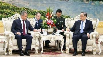China, Russia pledge to enhance military cooperation