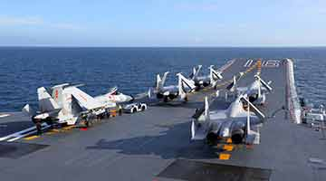 J-15 carrier-borne fighter jets aboard aircraft carrier Liaoning conduct realistic training