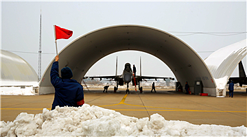 Su-30 fighter jets take off after snow