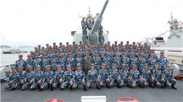 Chinese President Xi Jinping reviews naval parade in South China Sea