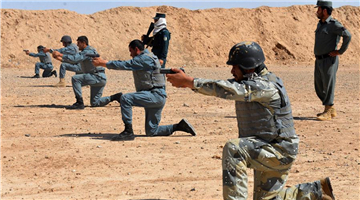 Policemen take part in military training in Afghanistan