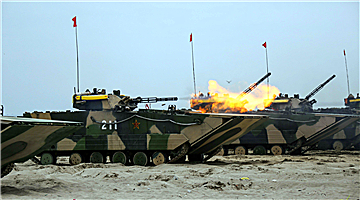 Amphibious armored vehicles conduct salvo of shells