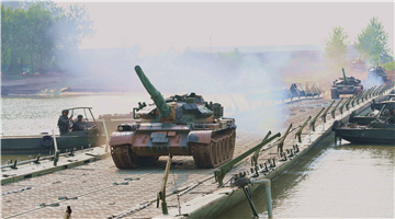 Tanks move on pontoon bridge over Yangtze River