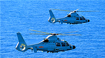 Z-9 helicopters fire missiles over South China Sea