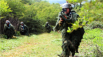 Special operations soldiers conduct tactical movement