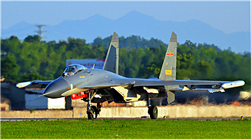 J-11 fighter jet takes off at night