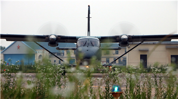 Y-12 transport aircraft takes off at night