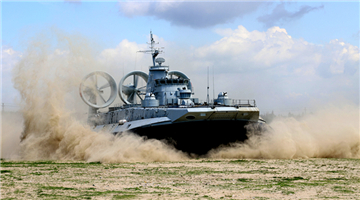 LCAC blows up sand as it lands on beach