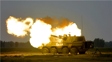Type-09 self-propelled howitzer system fires at targets