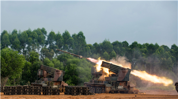 40-tube self-propelled multiple rocket launcher fires at targets
