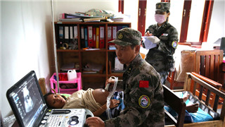 Chinese army medics help to ensure health of Lao victims following dam collapse