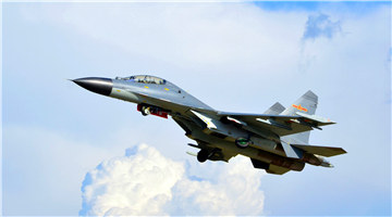 J-11 fighter jets participate in round-the-clock flight training