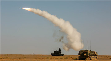 Multi-type air-defense missiles fire at targets in desert
