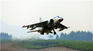 JH-7 fighter bombers take off for flight training