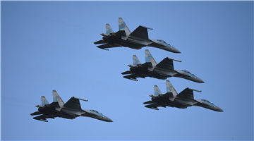 Su-35 fighter jets fly in formation