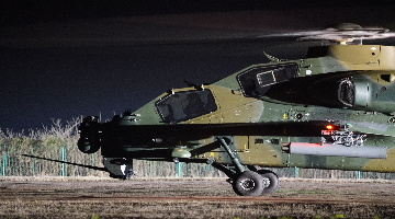 WZ-10 attack helicopters lift off at night