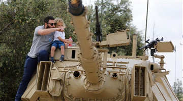 People visit Israeli Armoured Corps Memorial in Latrun on Memorial Day