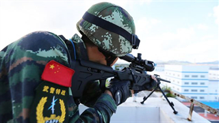 China honors 10 armed policemen as