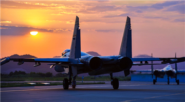 Fighter jets taxi to runway at sunset