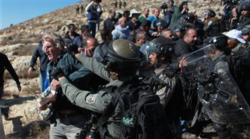 Israeli soldiers detain Palestinian protester in West Bank village near Hebron