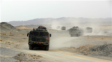 Military truck convoy en route to training field