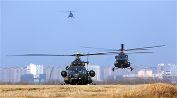 Mi-171 transport helicopters fly in formation