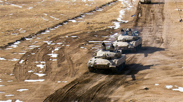 Armored vehicles engage in operational training