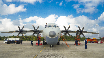 Maintenance men perform inspections on anti-submarine patrol aircraft