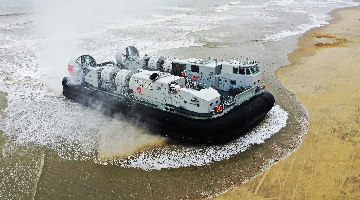 Air-cushioned landing crafts conduct beach landing training